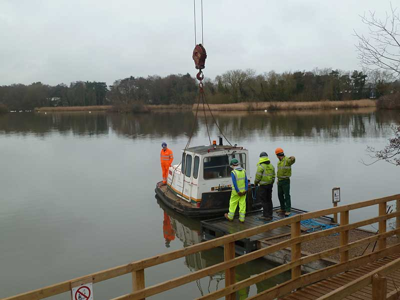 Lowering tug into water at Fleet Pond