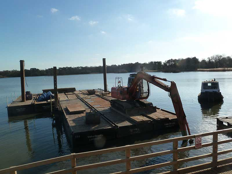 Tug pulls pontoon into position